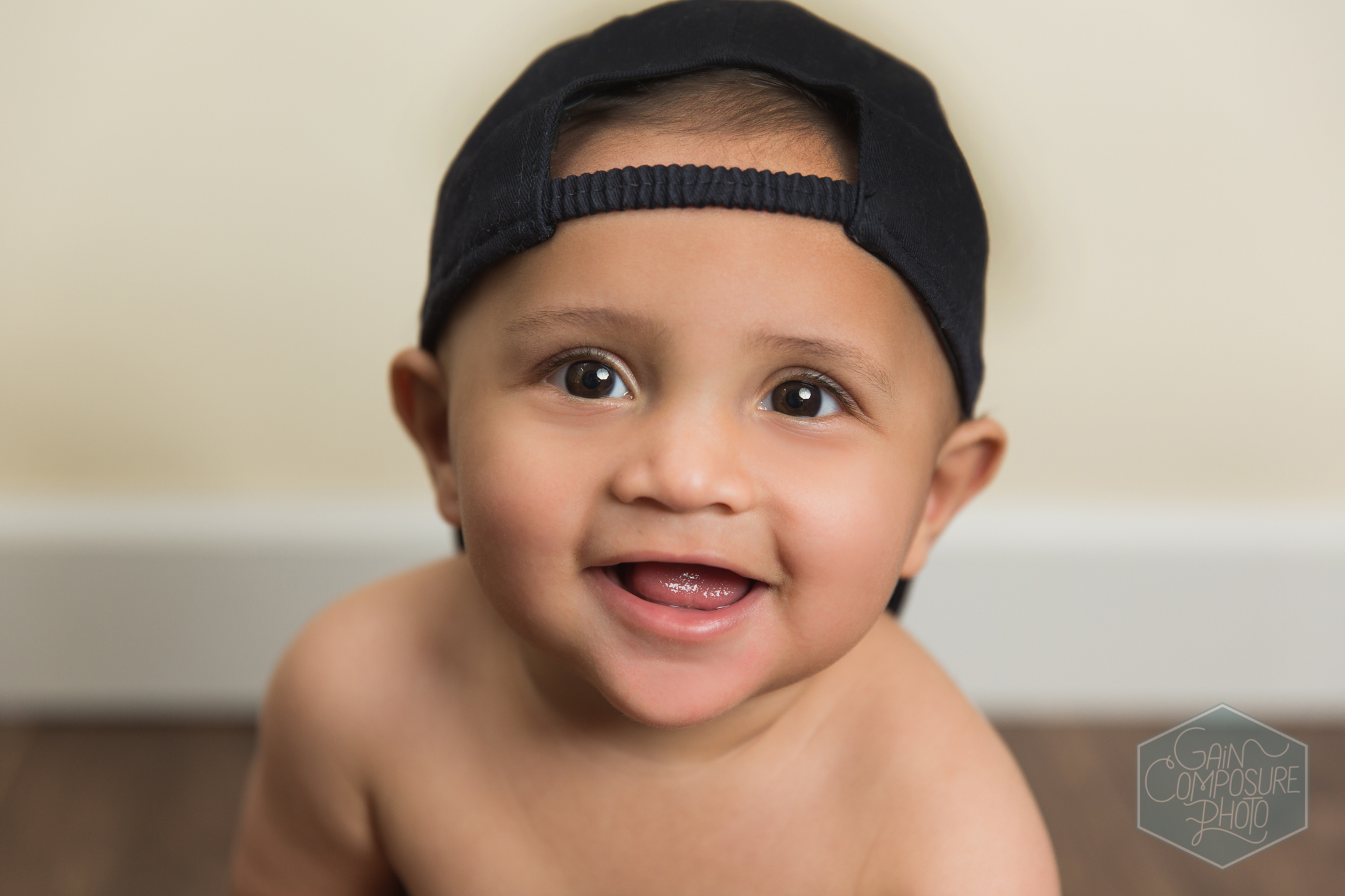 close up of boy in baseball hat