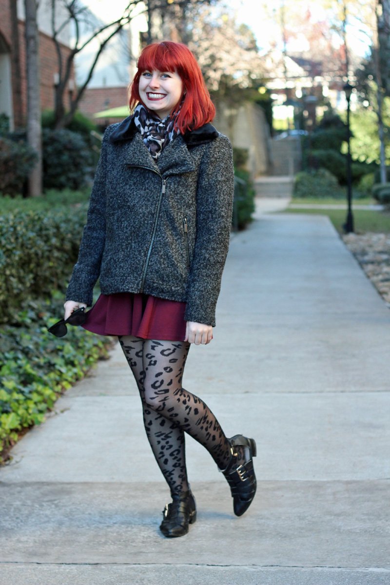 Gray Leopard Print Circle Scarf with a Textured Winter Coat with Fur Collar, Maroon Skater Skirt, and Leopard Print Tights