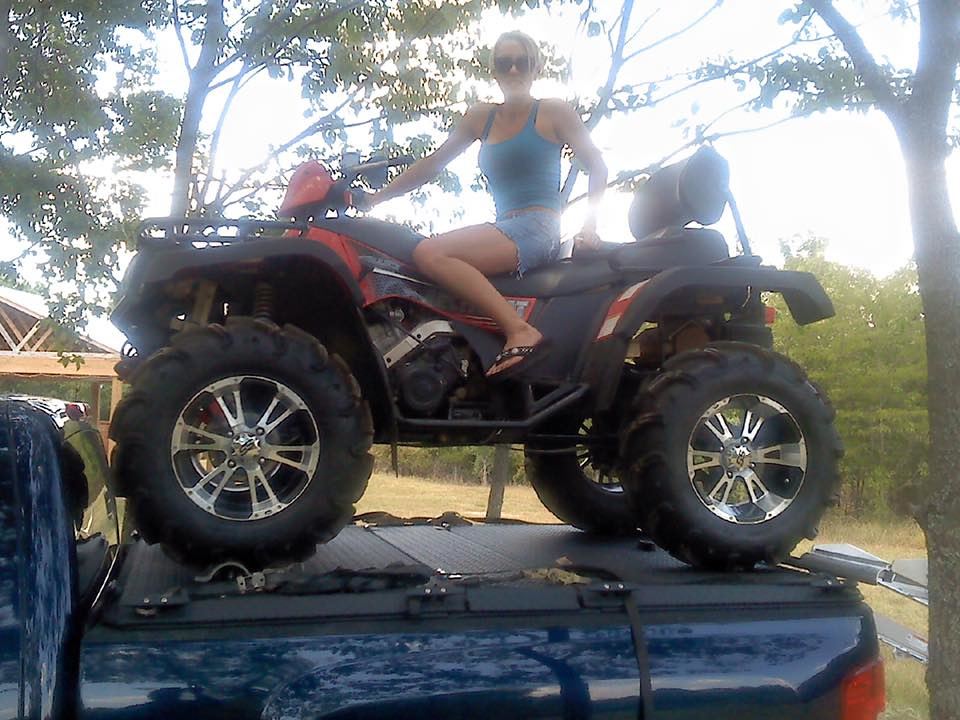 A Woman On An ATV Poses Atop A Heavy Duty Truck Bed Cover ...