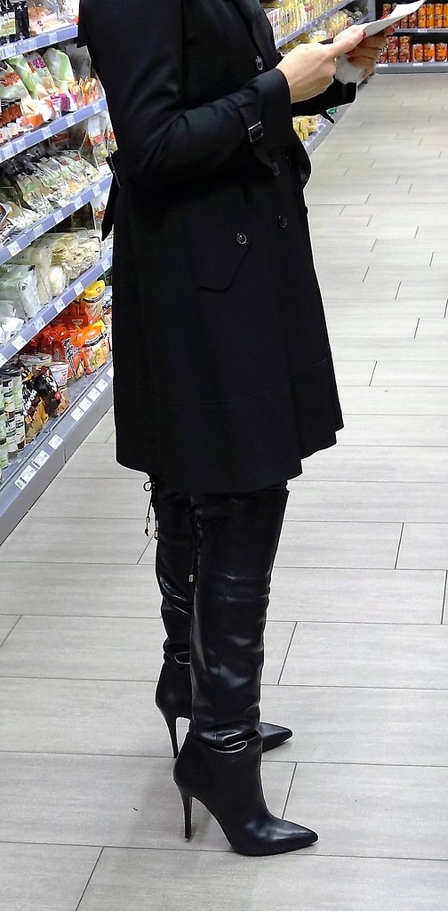 rosina in the shopping mall wearing thigh high boots