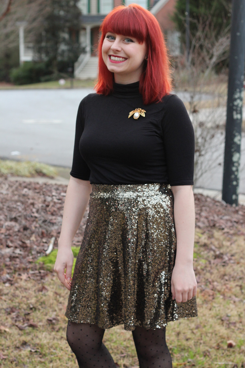 Sequined Gold Flippy Skirt with a Black Turtleneck Shirt and Beetle Brooch
