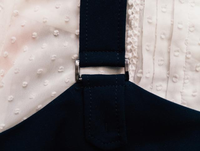 strap of navy pinafore dress