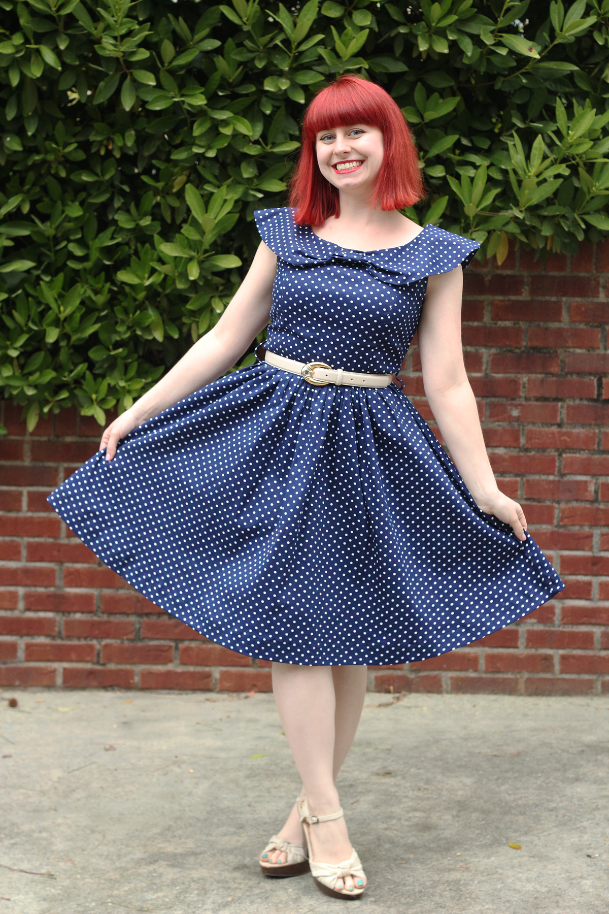 Lindy Bop Hetty Dress in Navy Blue Polka Dots, Off White Belt, and Peep Toe Heels