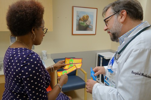 A doctor reviewing Food Bucks information with a patient