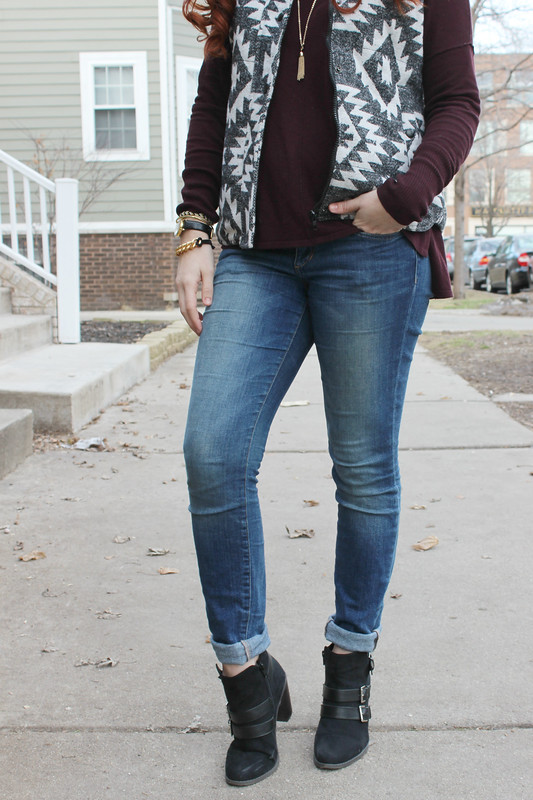 Outfit from the waist down. Puffer vest over burgundy sweater. Joe's jeans with cuffed bottoms and cute black and gold booties.