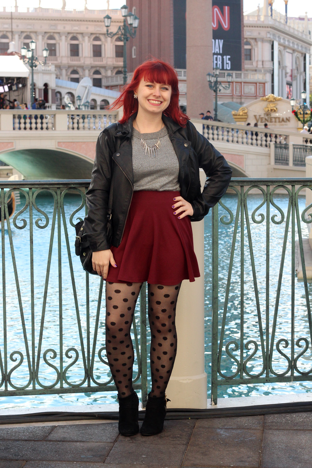 Silver Sweater, Leather Jacket, Maroon Skater Skirt, and Polka Dot Tights in Vegas