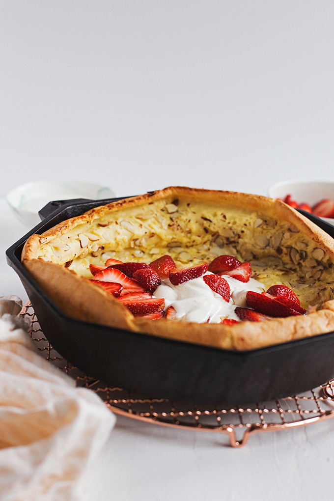 Almond Dutch Baby with Vanilla Bean Crème Fraîche and Strawberries