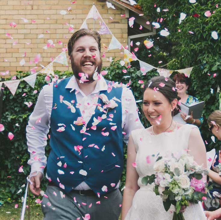 a confetti shower of rose petals, raining down as we stride down the aisle, newly married