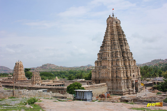 view of Virupaksha temple tower and complex from Hemakuta Hill in Hampi, Karnataka, India