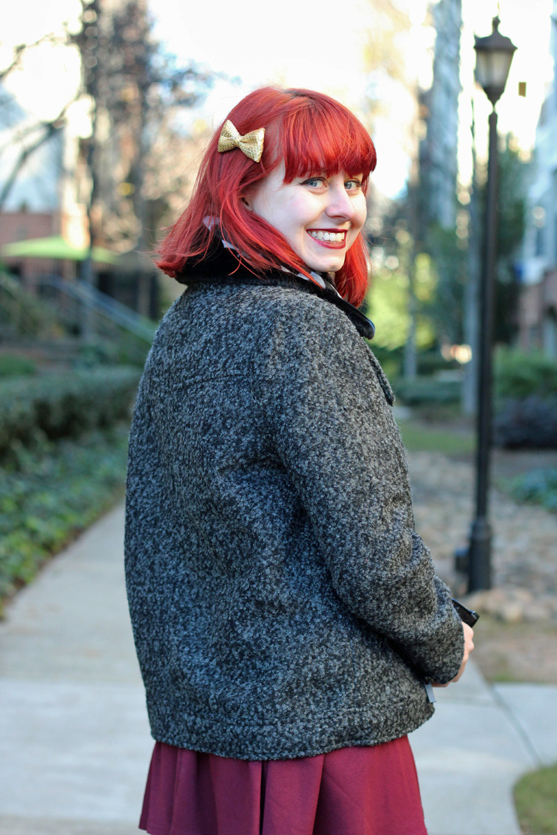 Gold Hair Bow, Red Hair, and a Gray Winter Jacket