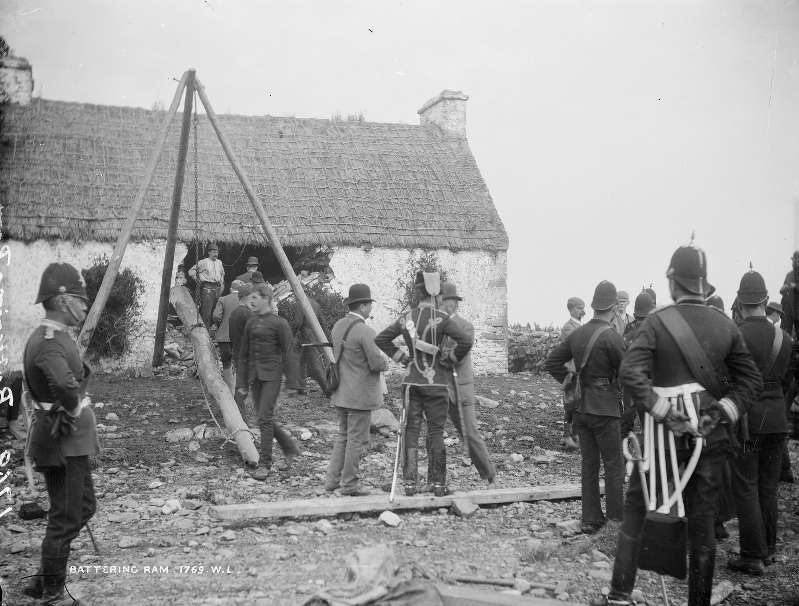 T.Birmingham's house, Moyasta, Co.Clare with Battering Ram and soldiers outside | by National Library of Ireland on The Commons