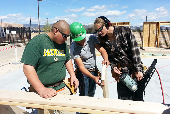 Students at Santa Fe Community College learn on-the-job while building a house for a low-income family.  The program, YouthBuild, was funded through a grant developed and written though a partnership with Los Alamos National Laboratory.