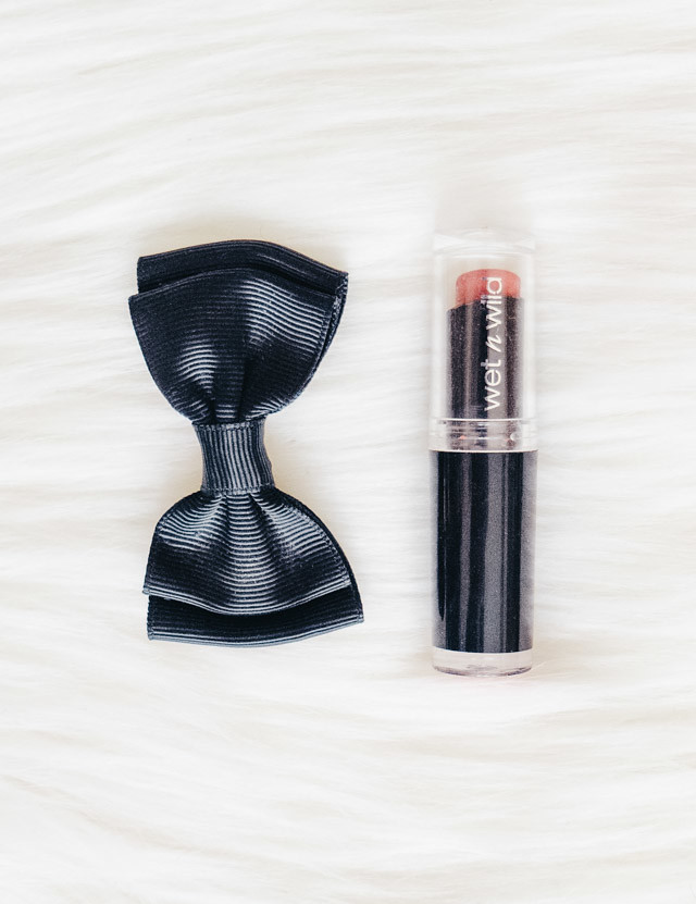 black bow and wet n wild lipstick