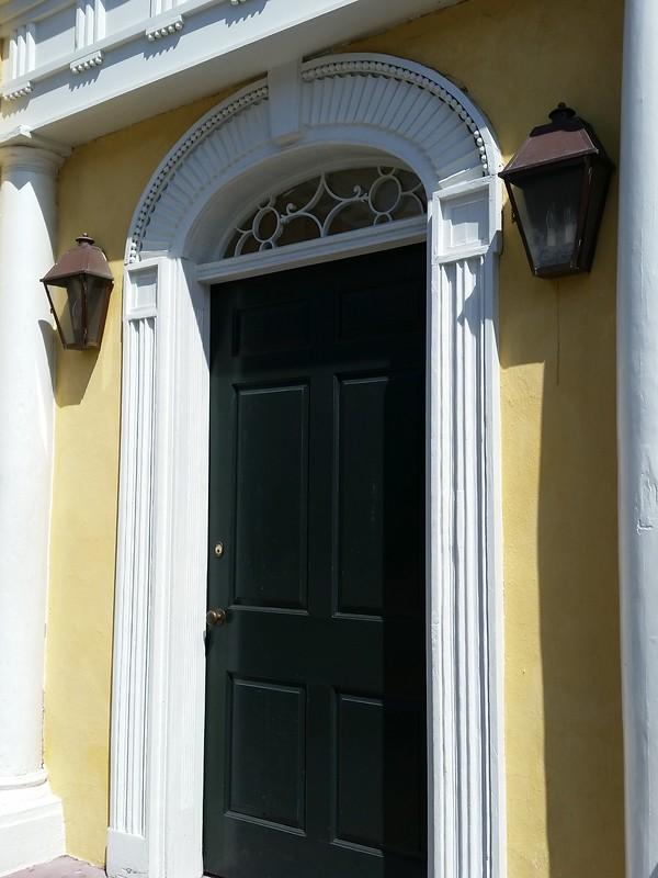 door with arched trim