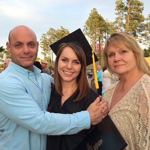 Photo of Autumn with her father and mema after graduation ceremony