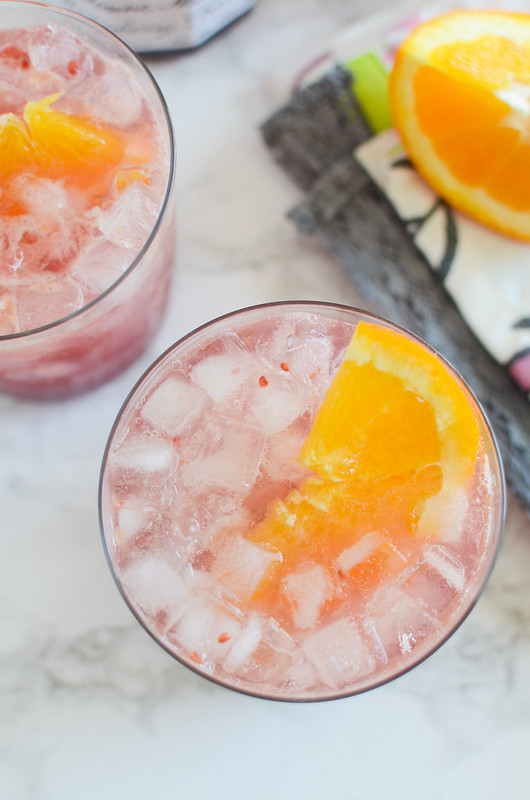 Raspberry Bourbon Smash - delicious cocktail for spring or summer! Raspberry, fresh orange juice, and bourbon!