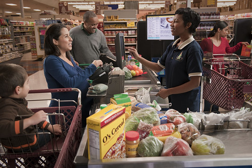 A woman shopping at the grocery store
