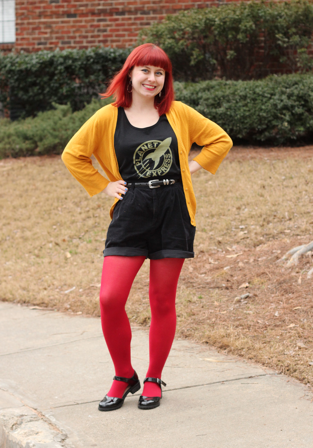 Mustard Yellow Cardigan, Planet Express Futurama Tank Top, Corduroy Shorts, Red Tights, and Patent Mary Janes