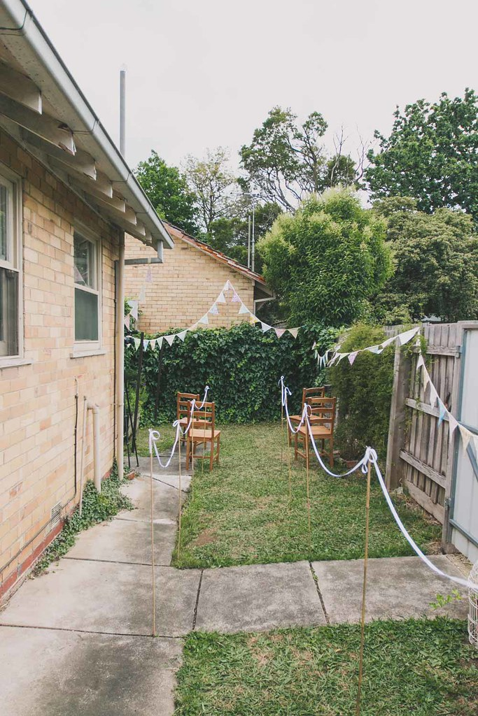 the backyard of our house in blackburn, complete with wedding bunting
