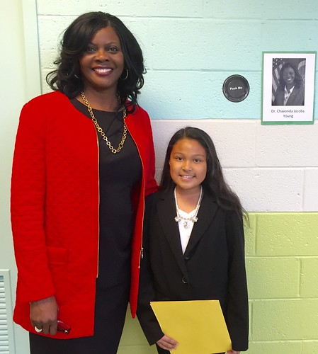 ARS Administrator Dr. Chavonda Jacobs-Young (left) standing with an elementary school student