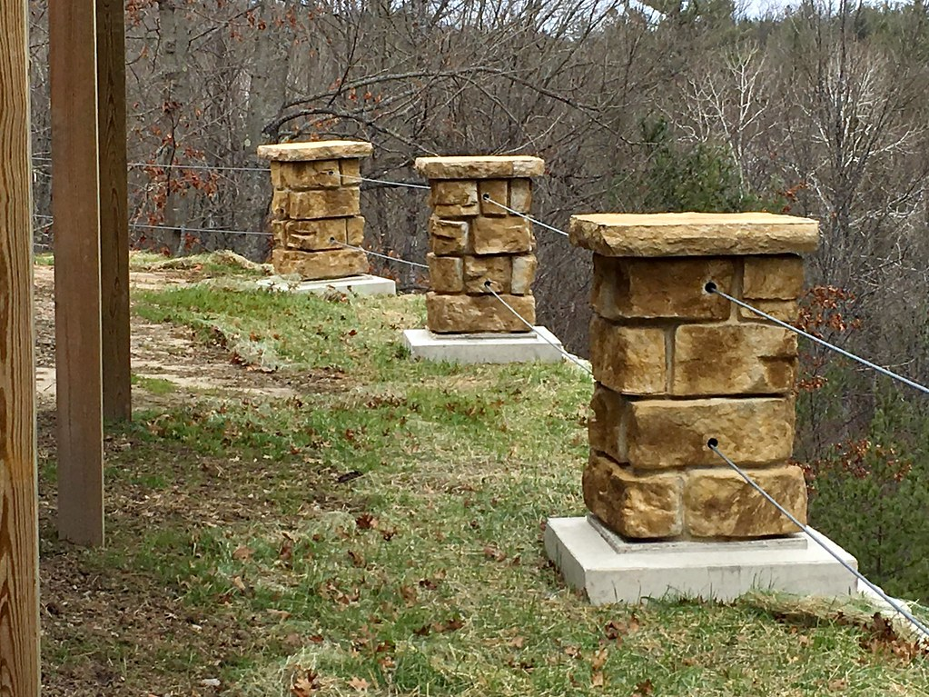 Precast Pole Bases as Columns on retaining wall