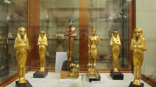 Ancient Egyptian deities , King Tut and his Golden statue