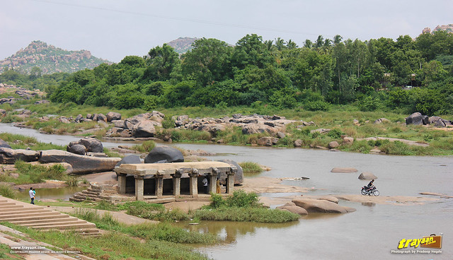 Rocks, stones and pavillions in Tungabhadra river that flows beside Virupaksha Temple complex, Hampi, Ballari district, Karnataka, India