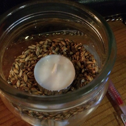 A tealight candle nestled into a jar half-filled with barley, for stability.