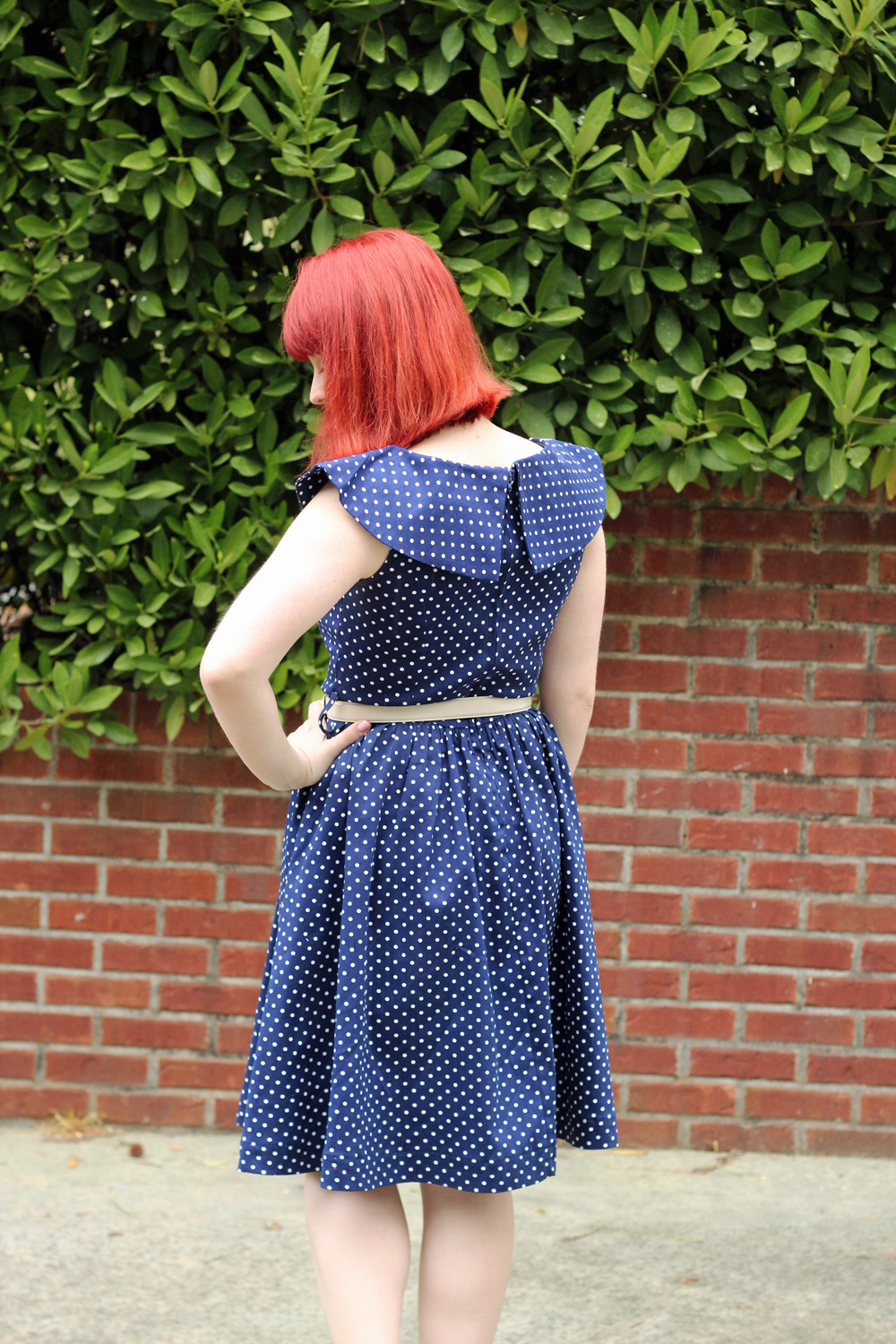 Red Blunt Bob and Shawl Collar Polka Dot Dress