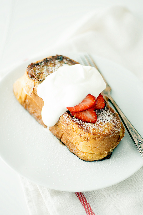 perfect for Easter or Mother's Day Brunch! Stuffed french toast, topped with whipped cream and strawberries, this strawberry shortcake french toast is a breakfast lovers dream.