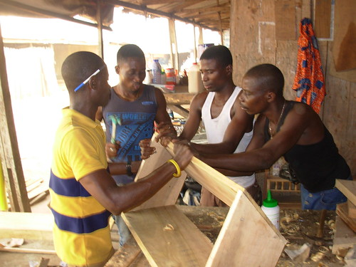 Four carpenters working