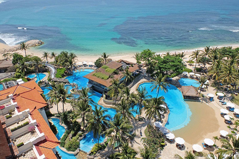 9 bali beach resorts with amazing water slides and kid pools for Indonesia resorts bali
