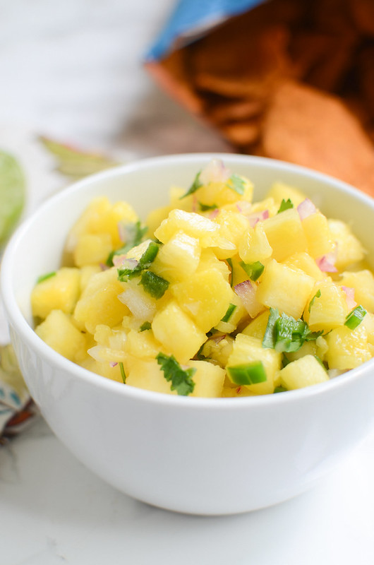 Pineapple Salsa - perfect on tacos, burritos, or just with tortilla chips! Really easy and really delicious!