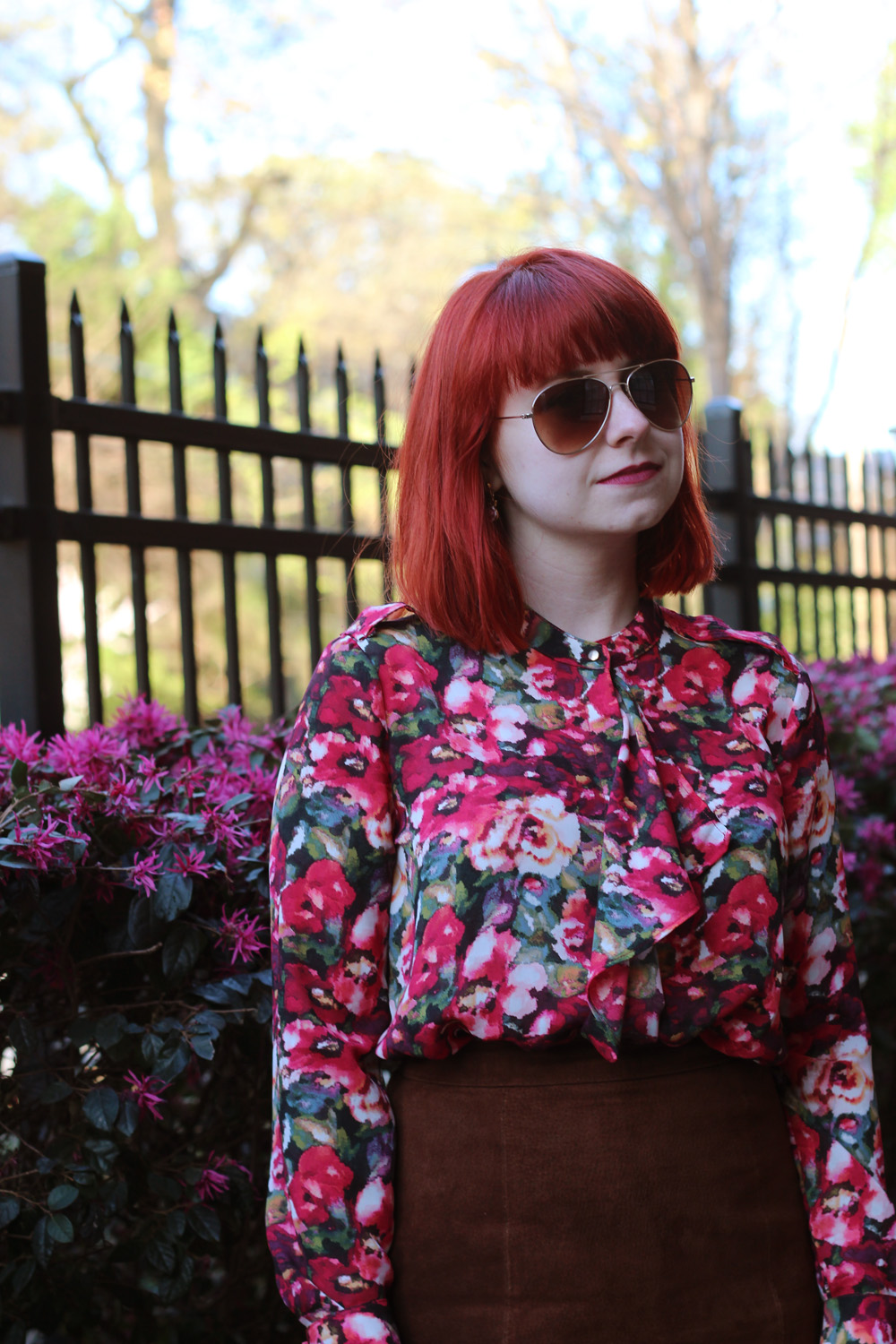 Digital Floral Print Top with Ruffles, Red Hair, and Gold Rimmed Aviator Sunglasses