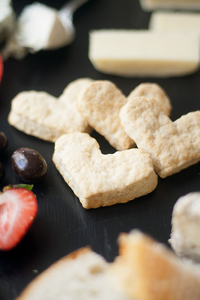 flat-bread crackers and a valentines day cheese board