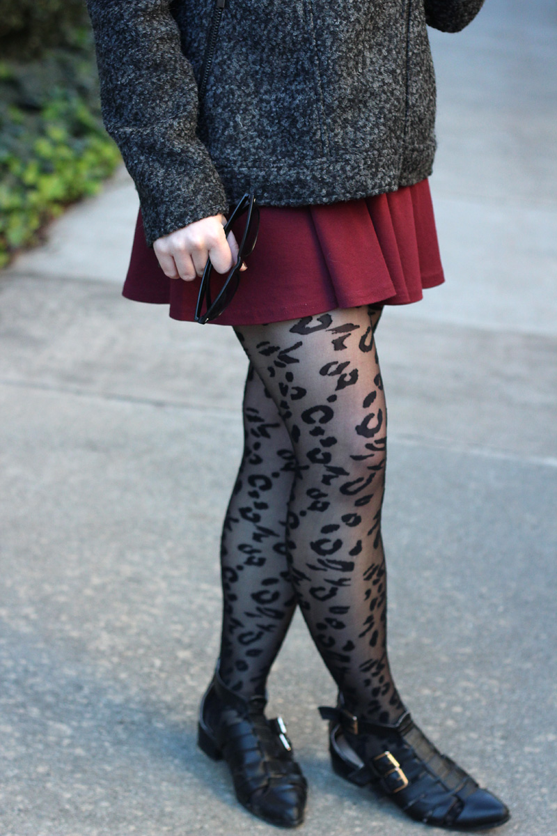 Sheer Black Leopard Print Tights with a Maroon Skirt, and Flat Cutout Boots