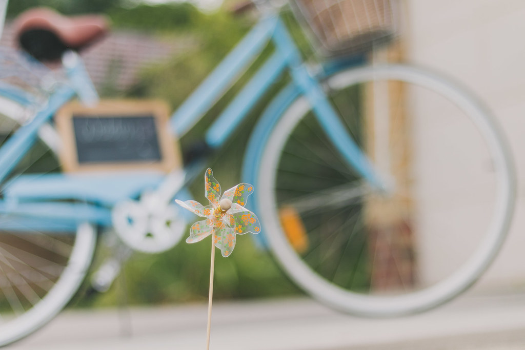 close up of a pinwheel, with my bike behind