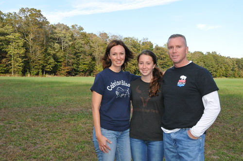 The Lester family with their reseeded pasture in the background