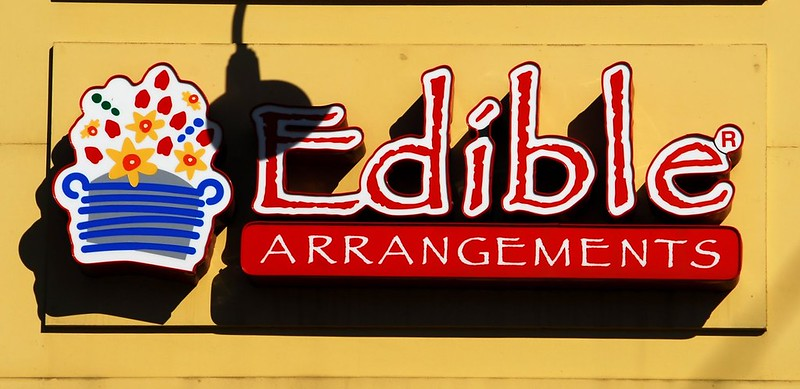 A sign outside at an Edible Arrangement franchise