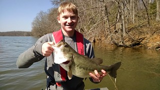 Photo of man holding largemouth bass