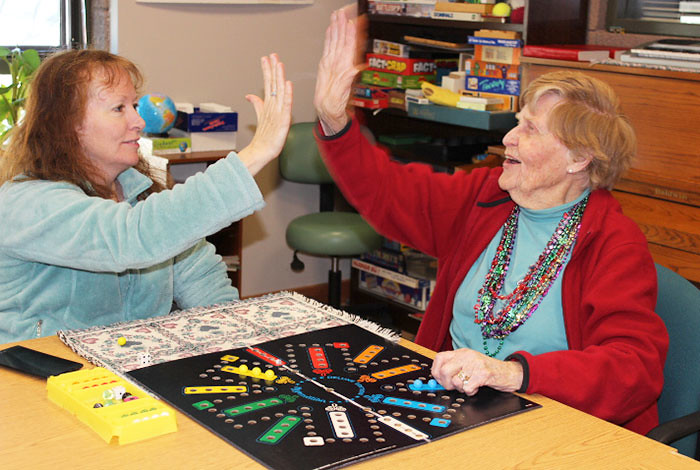 "Betty Ehart Senior Center staffer Susie Eash challenges Pat Day on their daily match of ""Aggravation."""