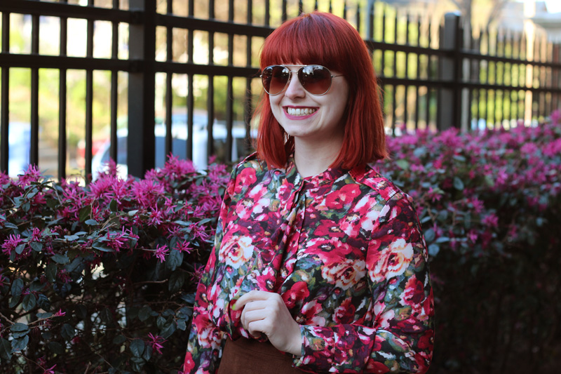 Aviator Sunglasses and a Digital Floral Print Blouse with a Center Ruffle
