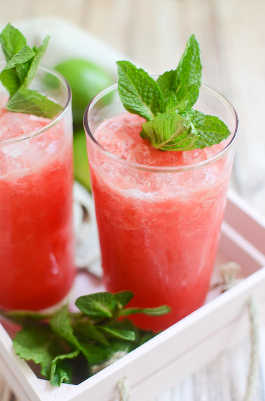 Watermelon Mint Margaritas - the most refreshing summer cocktail! Fresh watrmelon is blended with tequila, lime juice, and an easy homemade mint simple syrup. These margaritas are so pretty and so delicious!