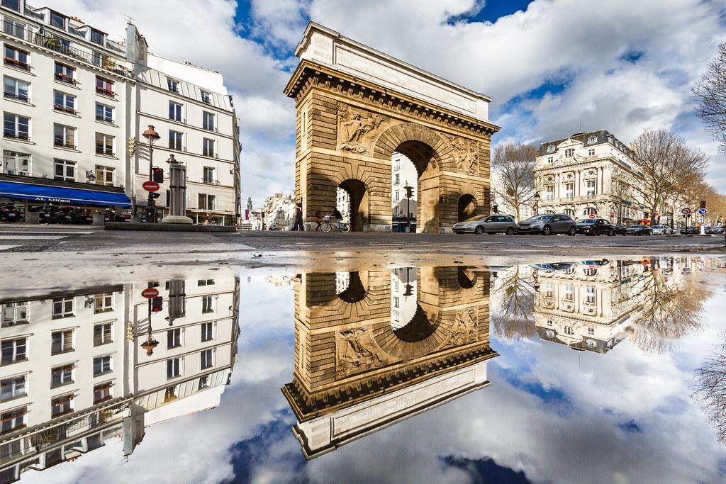 Porte saint martin in paris puddle mirrored it was a for Porte saint martin