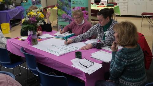 volunteers writing on paper