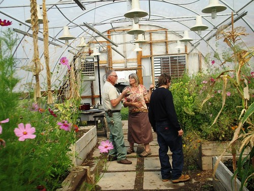 Boxelder instructors Jerry Hood and Rae Rowell, along with student Seth Brand-Tindale admiring the flowers and vegetables in the Center's greenhouse