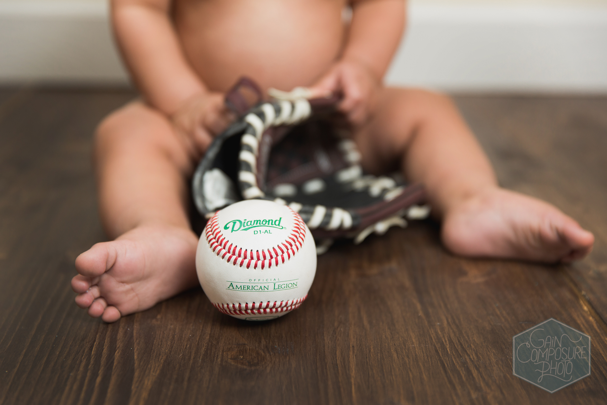 8 month old with ball and glove