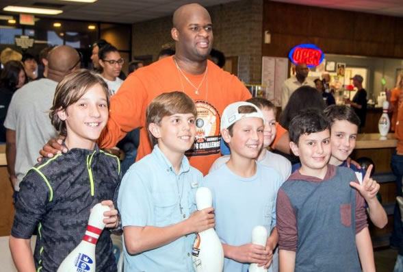 Vincent Young and young Austinites have fun at the bowling tourney.
