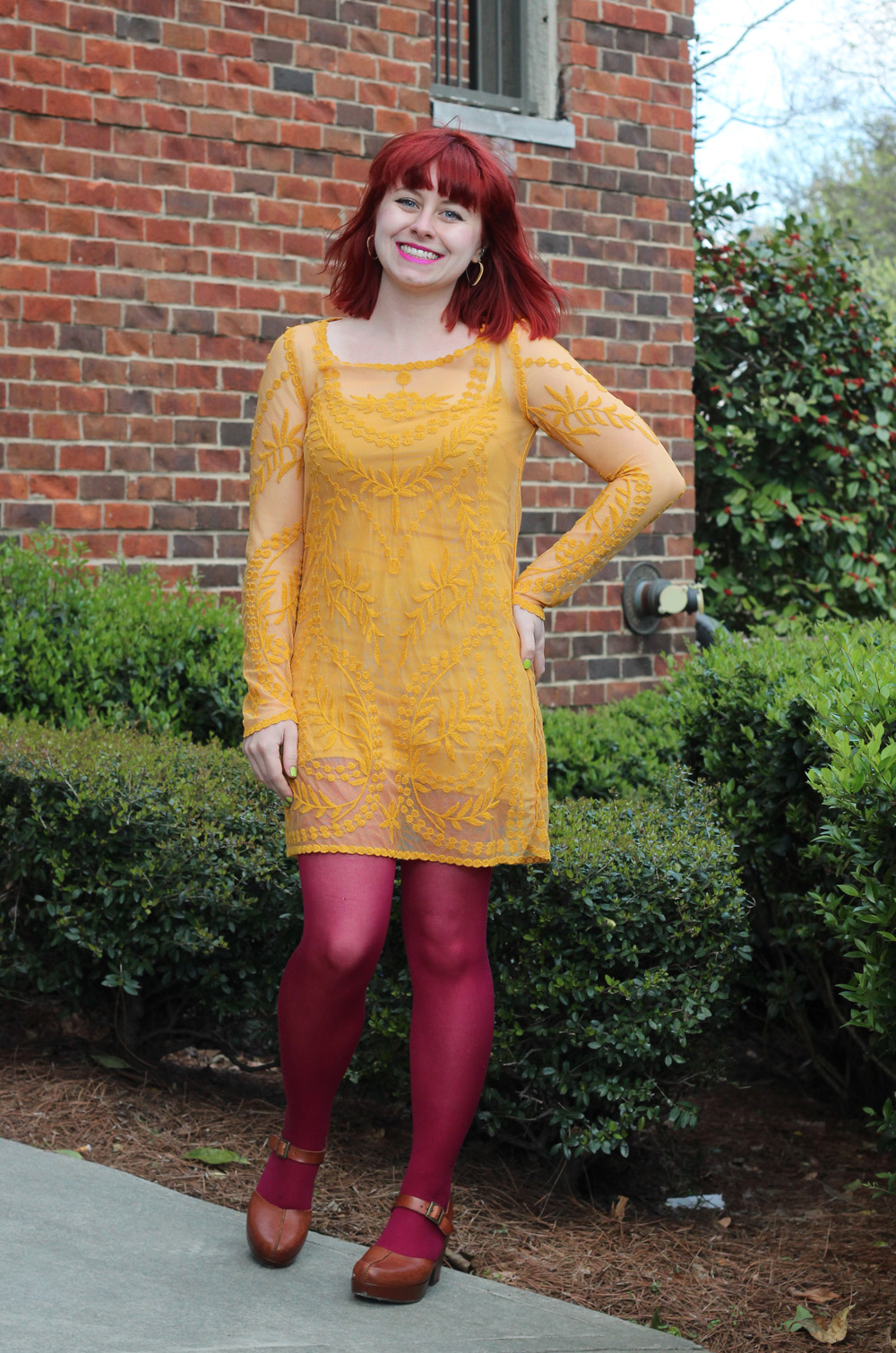 Sheer Embroidered Mustard Yellow Dress, Bright Pink Tights, and Clogs