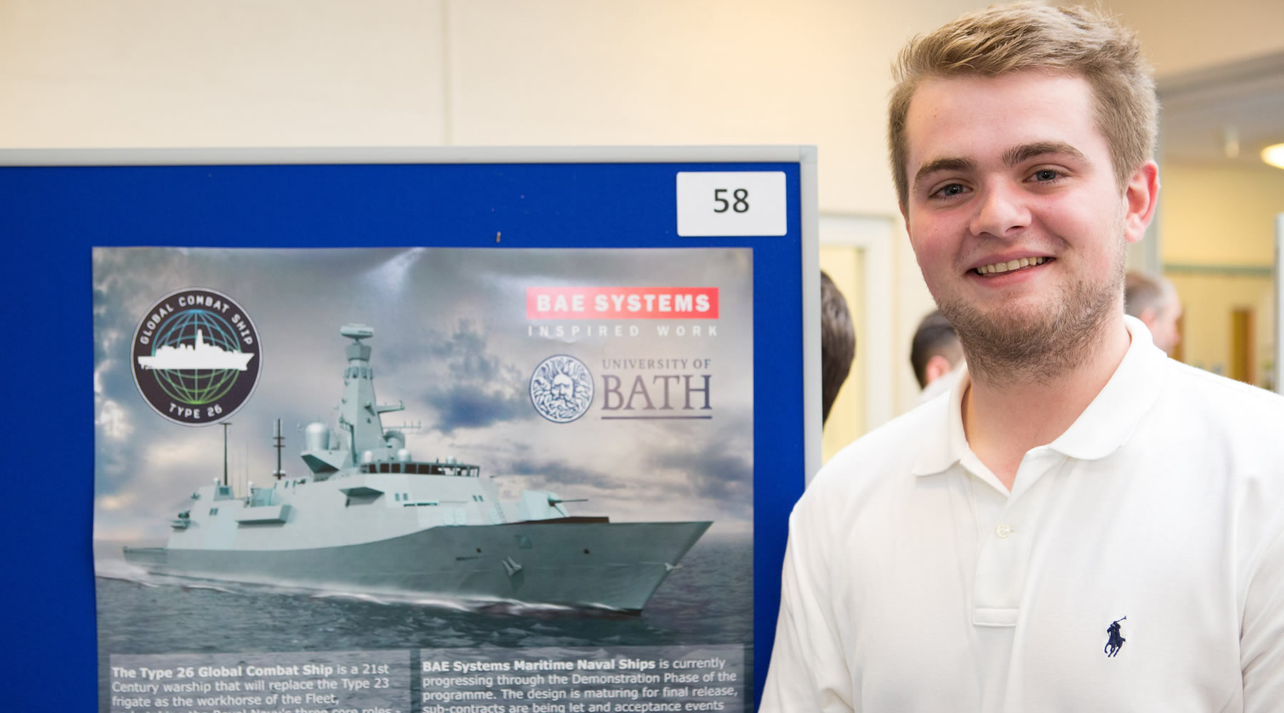 Photo of Stephen Dickie with his poster about his placement at BAE Systems.